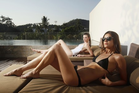 Women in bikini relaxing on lounge chair Stock Photo - 7534937