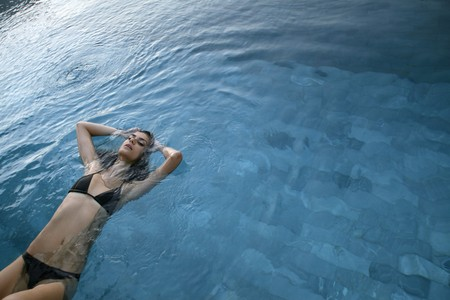 Woman relaxing in swimming pool Stock Photo - 7535054