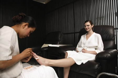 Woman enjoying her pedicure treatment photo