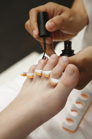 Woman receiving pedicure photo