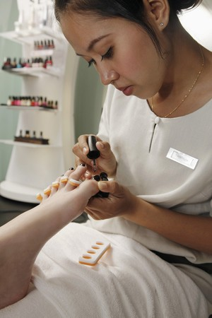 Woman giving pedicure photo