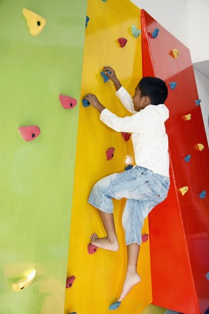 Boy climbing rock wall Stock Photo - 7534783