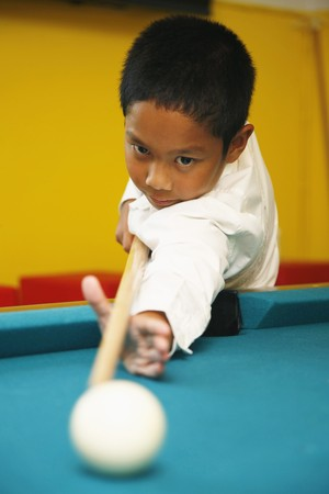 Boy playing pool photo