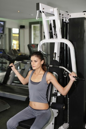 Woman working out in gymnasium photo