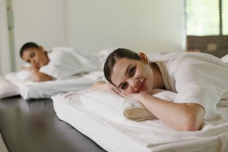 Women lying on massage table photo