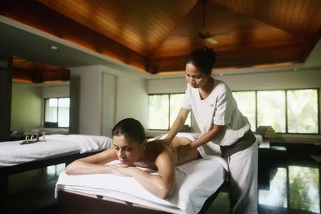 Woman receiving a back massage Stock Photo - 7534662