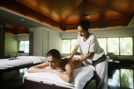 Woman receiving a back massage Stock Photo - 7534662