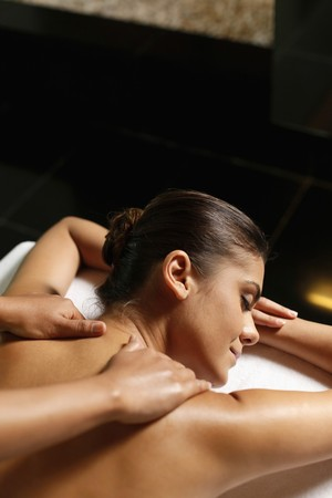 Woman receiving a back massage Stock Photo - 7534374