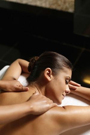 Woman receiving a back massage Stock Photo - 7534374