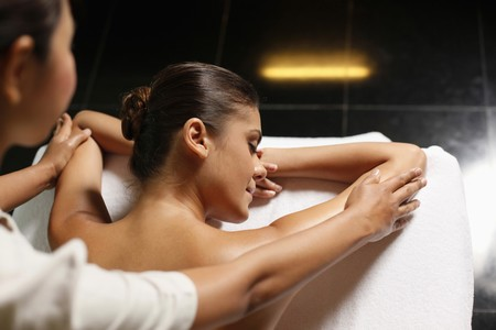 Woman receiving a back massage photo