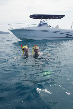 Man and woman snorkeling in the ocean photo