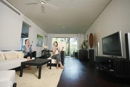 Women singing karaoke at home photo