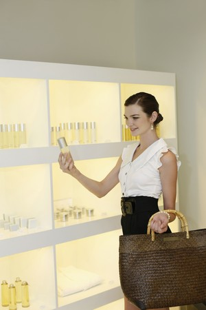 Woman shopping for beauty products photo