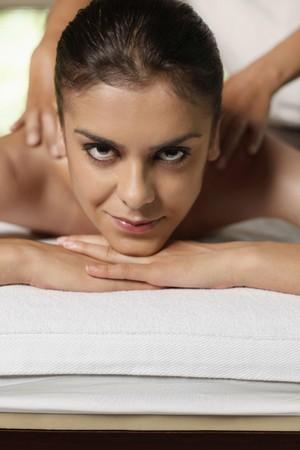 Woman receiving a back massage Stock Photo - 7595639