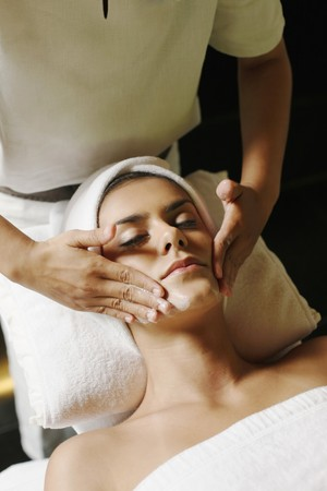 Woman in health spa, having her face washed photo