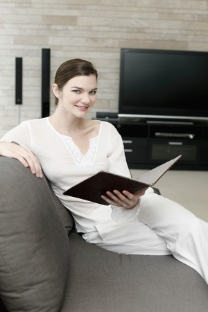 Woman holding a book and smiling Stock Photo - 7595193