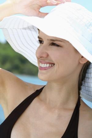 Woman in bikini wearing hat Stock Photo - 7595600