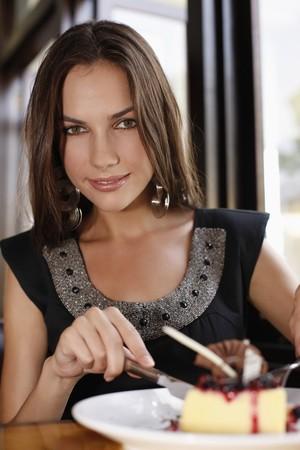 eating up: Woman eating dessert at restaurant