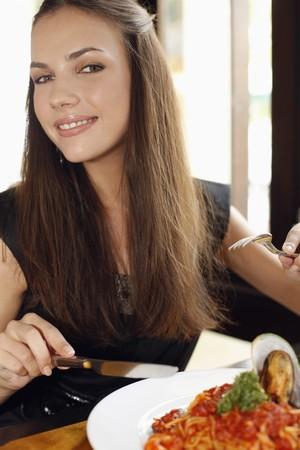 Woman eating seafood spaghetti photo