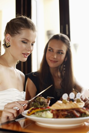 Women having lunch at restaurant photo