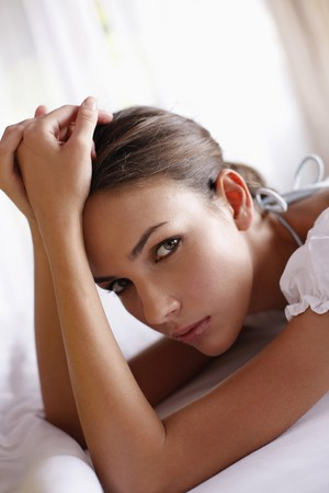 Woman lying on front on bed Stock Photo - 7594859