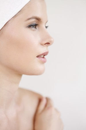 Woman with towel wrapped around head, hands on her shoulder Stock Photo - 7594966