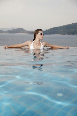Woman with sunglasses in pool Stock Photo - 7595497