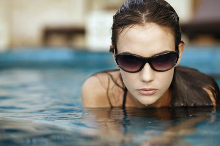 Woman with sunglasses in pool Stock Photo - 7594985