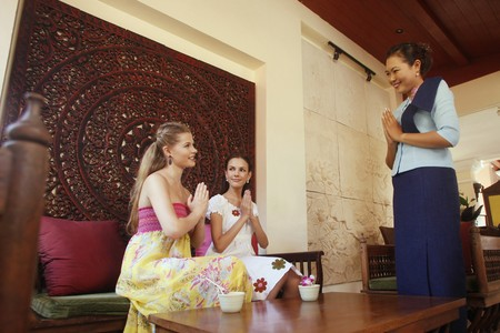 ukrainian ethnicity: Women greeting each other with hands clasped