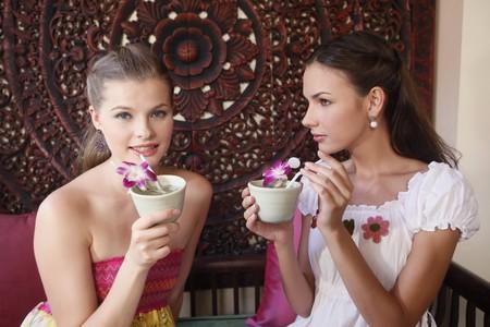Women enjoying tea photo