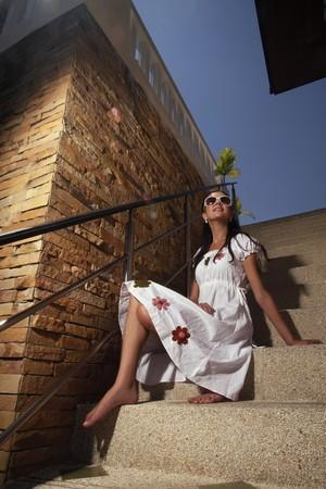 ukrainian ethnicity: Woman sitting on stairs