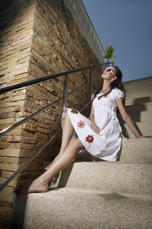 Woman sitting on stairs Stock Photo - 7595742