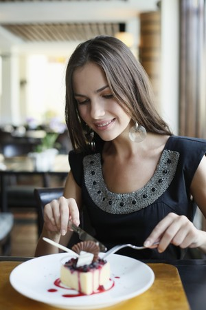 Woman eating dessert at restaurant photo