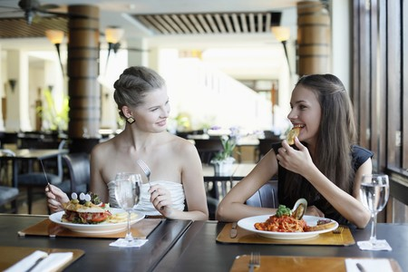 Women having lunch at restaurant Stock Photo