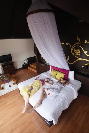 Women sleeping on bed photo