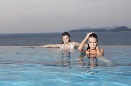 Women relaxing in pool photo