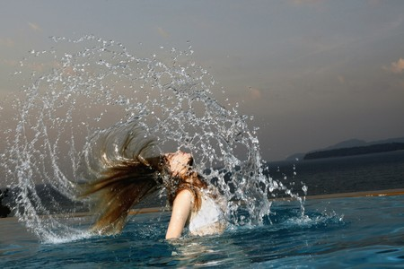 Woman in pool, head coming out of water photo