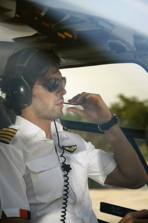 Pilot in helicopter Stock Photo - 7595258