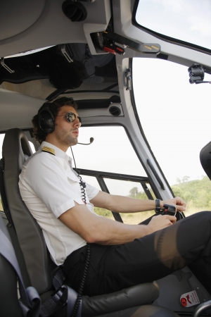 helicopter pilot: Pilot in helicopter