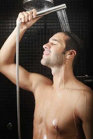 southeastern european descent: Man taking shower Stock Photo