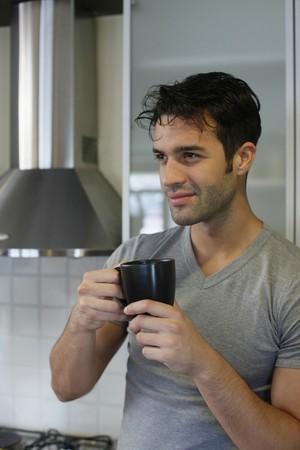 Man enjoying a cup of coffee photo