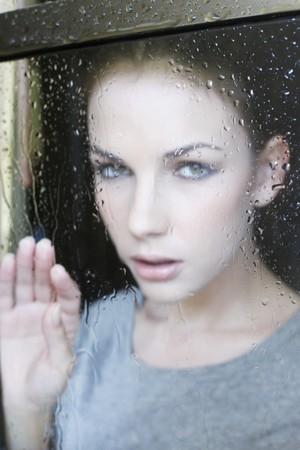 Woman looking through window photo