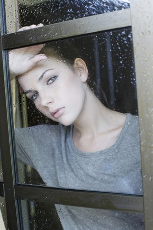 Woman looking through window photo