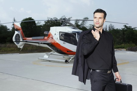 Businessman holding briefcase standing at helipad Stock Photo - 7595393