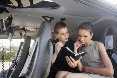 Businesswomen having discussion in helicopter photo