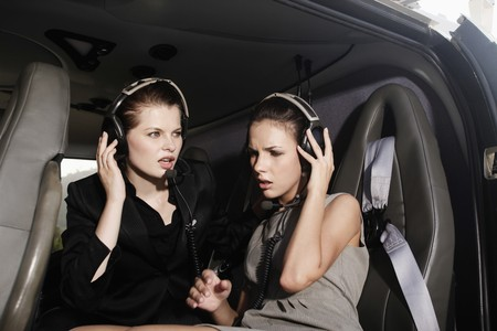 Businesswomen with headset in helicopter photo