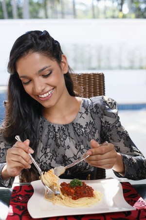 Woman enjoying a plate of spaghetti photo