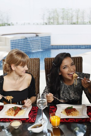 Women eating spaghetti photo