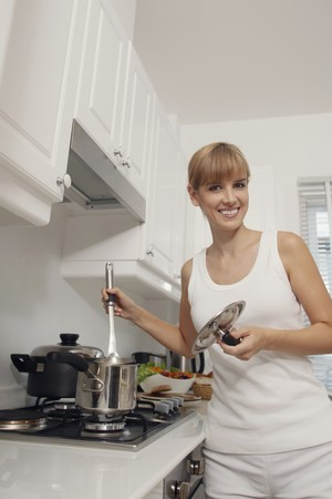 Woman cooking in kitchen photo