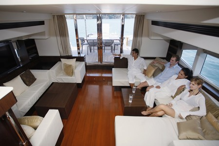 australian ethnicity: Couples watching television in yacht living room